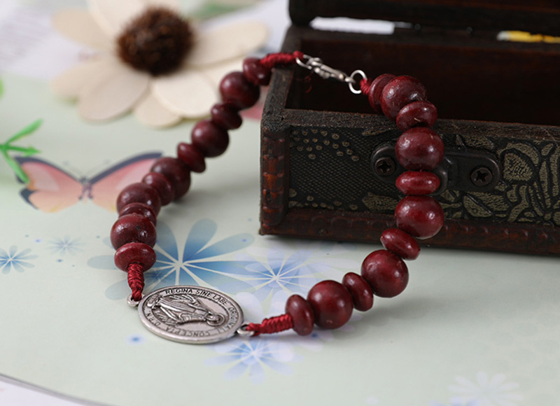 Dark red cord bracelet with pendant