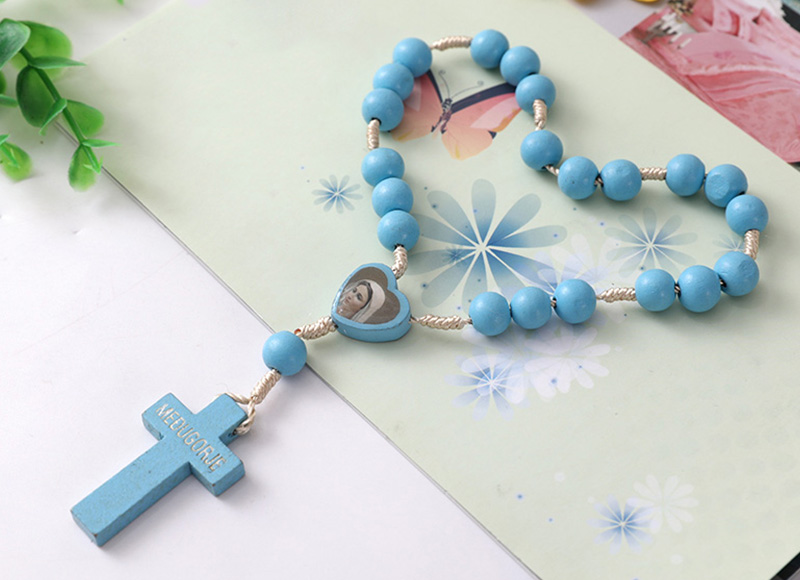 Blue wood rosary with heart shape bead